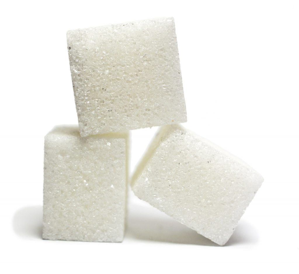 SUGAR INTAKE SHOULD BE REDUCED TO PREVENT TOOTH DECAY-min
